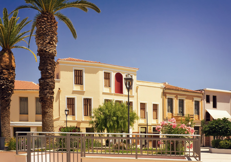 Buildings, trees and other plants in the Central square of the city of Rethymno, Crete, Greece. photo