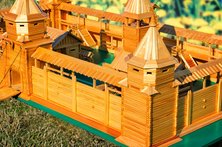 artful: Depicted artful is made of natural wood the layout of an ancient fortress with ramparts, towers, gates, stairs, outbuildings.