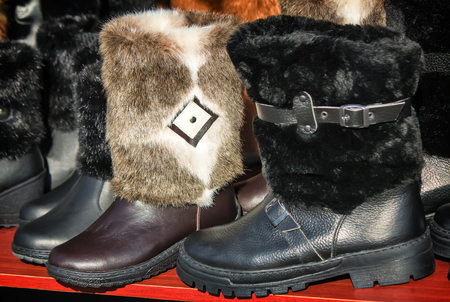 seasonal clothes: Warm shoes made of felt (felt boots) to work in the winter outdoors. Sold at the fair. Stock Photo