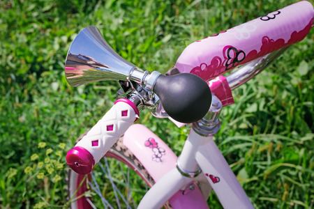decorated bike: Original sound signal on a bicycle wheel for the girl in style of a retro.