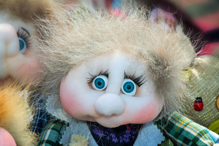 luxuriant: Funny doll of rags in the form of a little man with big blue eyes and luxuriant hair. Stock Photo