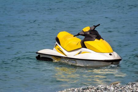 vacationers: In coastal water on the beach is a small single motor boat vacationers.