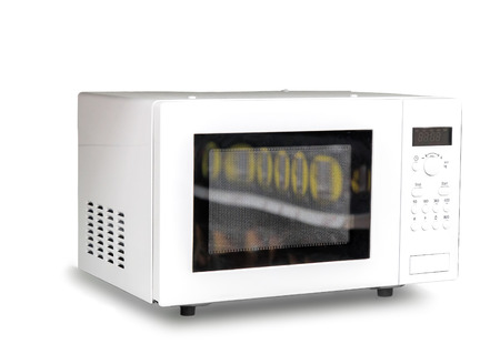 worktops: Modern microwave oven white . Presented on a white background.