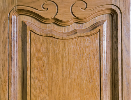 workmanship: The fragment panels of natural oak, decorated with beautiful wood carvings. Stock Photo