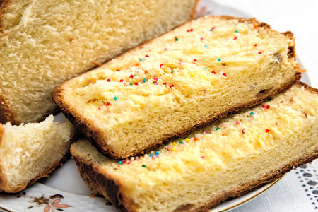 mouthwatering: On the plate is sliced mouth-watering sweet white bread. Presents closeup. Stock Photo
