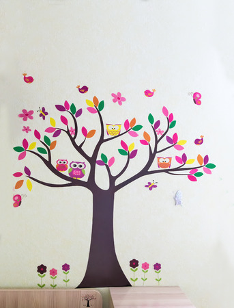 butterflies for decorations: Decorative panels on the wall of a childs room with the image of a tree with colorful leaves, birds, butterflies, flowers. Stock Photo