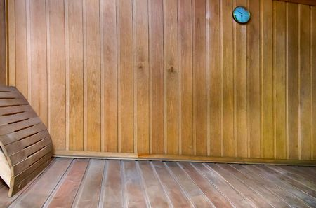 finnish bath: The interior of a small Finnish sauna with wooden walls.