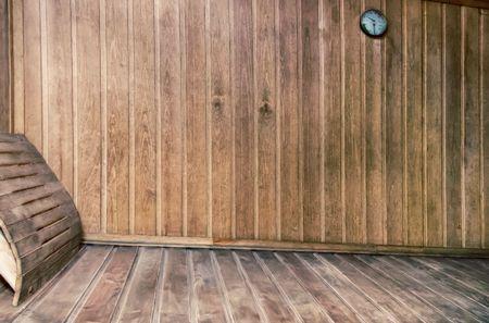 finnish bath: The interior of a small Finnish sauna with wooden walls.