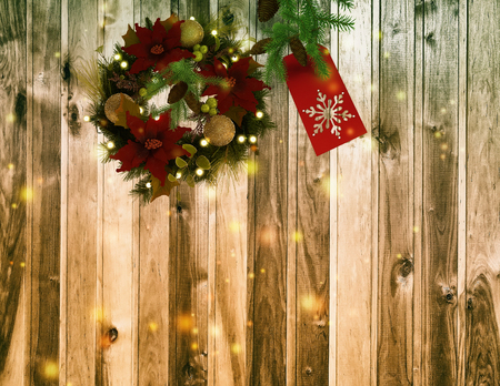 pinecones: On the surface of wood - Christmas decorations: pine branches, pinecones, beautiful wreath with flowers and balloons, glowing lights around..