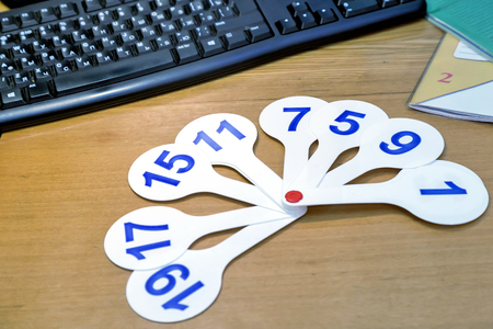 pedagogy: On the table lies a set of numbers that helps first graders learn to count. Stock Photo