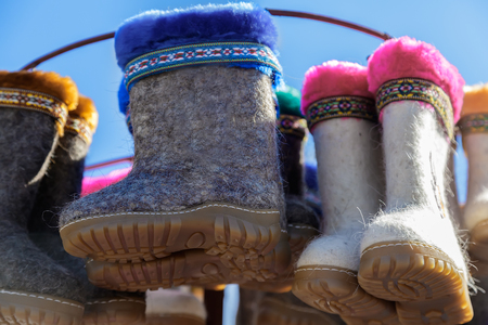 Childrens winter shoes made of felt (felt boots) for walking in cold seasons. Sold at the fair.