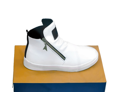In a shop window presents a box of comfortable athletic shoes on a white background.