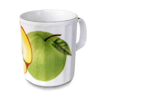 White ceramic Cup with green graphic Apple. Presented on a white background.