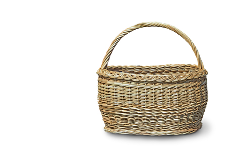 Spacious wicker basket with handle. Presented on a white background.