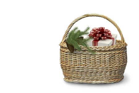 Christmas gifts: in a large wicker basket is a box of gift and spruce branches with cones. Presented on a white background. 3D rendering