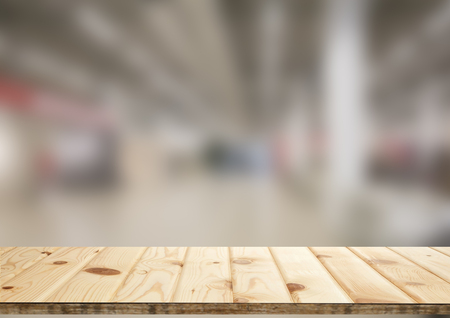 Background image: wooden countertop on blurred background the interior of the Mall. Can be used for display or installation of your products Stock Photo