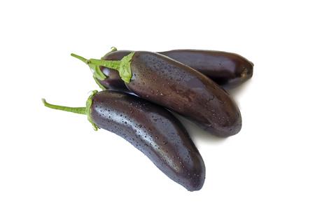Three ripe eggplant. Presented on a white background. Stock Photo