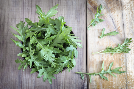 Green fresh arugula leaves on the table. Presented in close-up. Stock fotó - 102975581