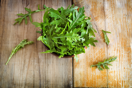 Green fresh arugula leaves on the table. Presented in close-up.