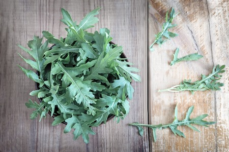 Green fresh arugula leaves on the table. Presented in close-up. Stock fotó - 104118004