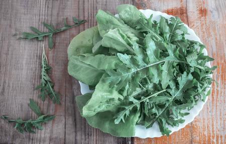 Fresh green leaves of arugula on the table Stock fotó - 111481733