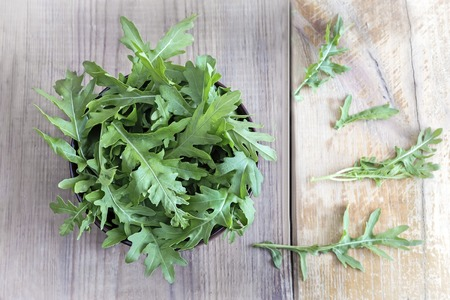 Green fresh arugula leaves on the table. Presented in close-up. Stock fotó - 115069878