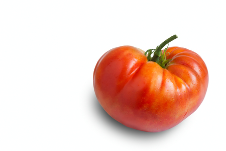 On a white background red ripe large tomato with a peduncle. Imagens - 117199283