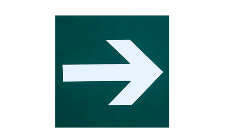 A sign on the wall with a direction indicator in the form of an arrow. Presented on a white background. 写真素材