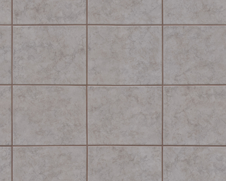 A fragment of the walls of the house are covered with ceramic tiles that mimic natural stone.
