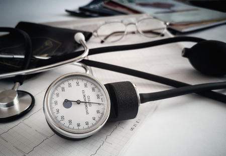 Against the background of medical documentation medical instruments: stethoscope for auscultation of patients and apparatus for measuring blood pressure.