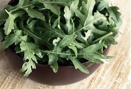 Green fresh arugula leaves on the table. Presented in close-up. Stock fotó - 127998636