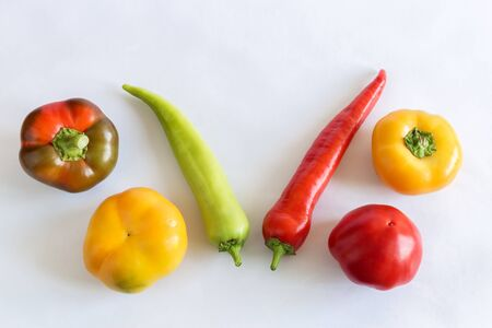 On a light background, six bell peppers of different colors and shapes. 写真素材