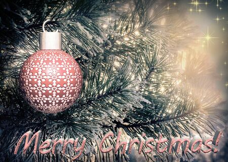 Beautiful Christmas card in vintage style with the image of a Christmas tree, decorated with toys and greeting inscription