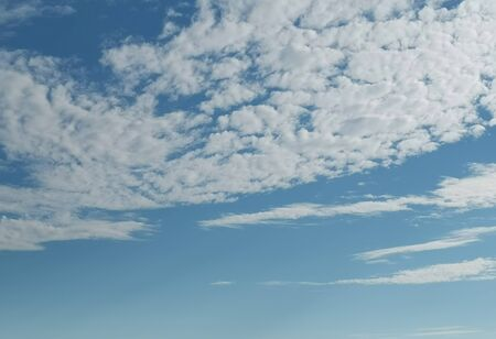 Blue sky and white fluffy clouds. Background image.