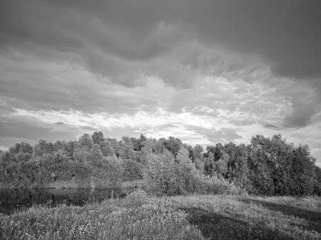 Landscape with a stormy sky at sunset. 写真素材