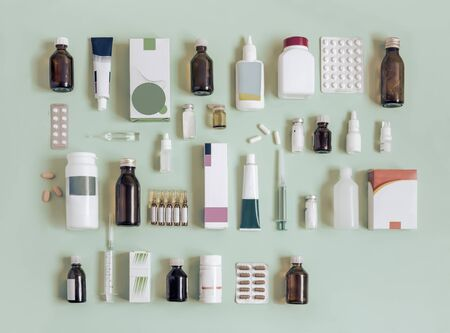 Various forms of medicines on a light green background