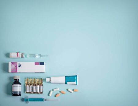Different shapes of drugs on blue background