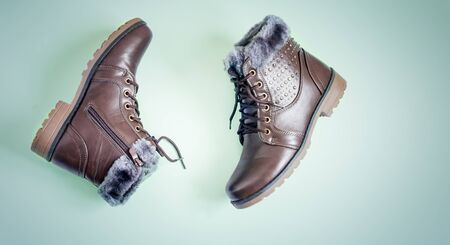 Comfortable winter boots with lacing and zipper closure. 写真素材