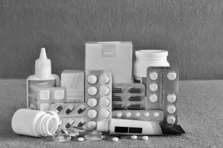 Various forms of drugs: tablets, ampoules, tinctures, blister packaging on a light background. The place to insert the text. Medicine and pharmacy. 写真素材