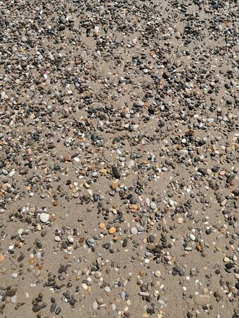 Background image: small sea pebbles on the beach