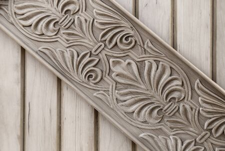 Background image made of natural wood with a pronounced wood structure and wood carvings. Presented in close-up. Stock Photo