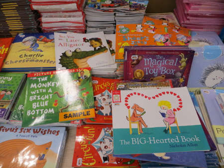 TANGERANG, INDONESIA - April 9, 2018: Stacks of children books for sale on books fair at ICE BSD City. Editorial