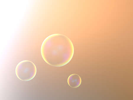 Three soap bubbles flying in orange background