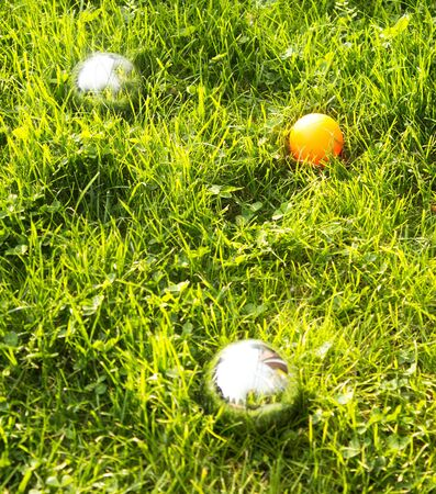 bocce ball: The bowls  balls on a green grass