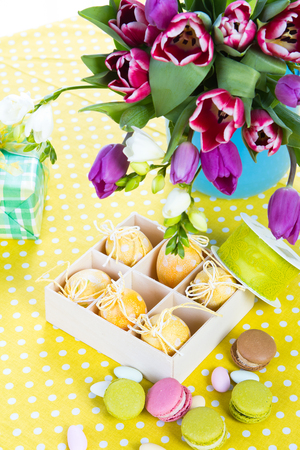 Bunch of Tulips and Sweets on the Table