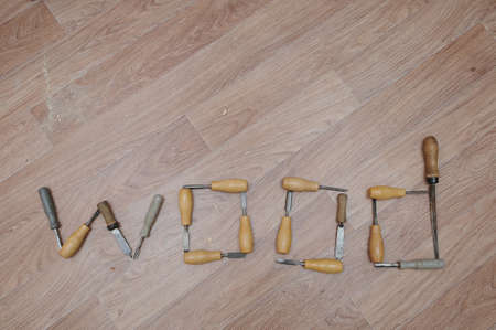 chisels: Word wood lettering.  lathe chisels selection on the wooden table Stock Photo