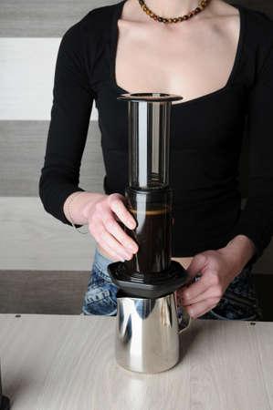 inverted: Professional barista coffee brewing. Inverted aeropress method