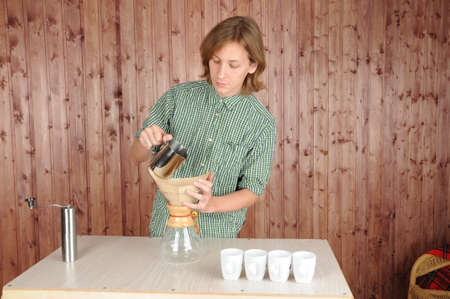 Professional barista preparing fresh coffee alternative method