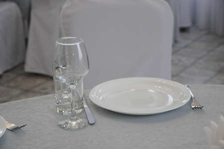 Empty white dinner plate on a table in a restaurant 写真素材