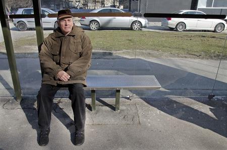 Senior at bus station